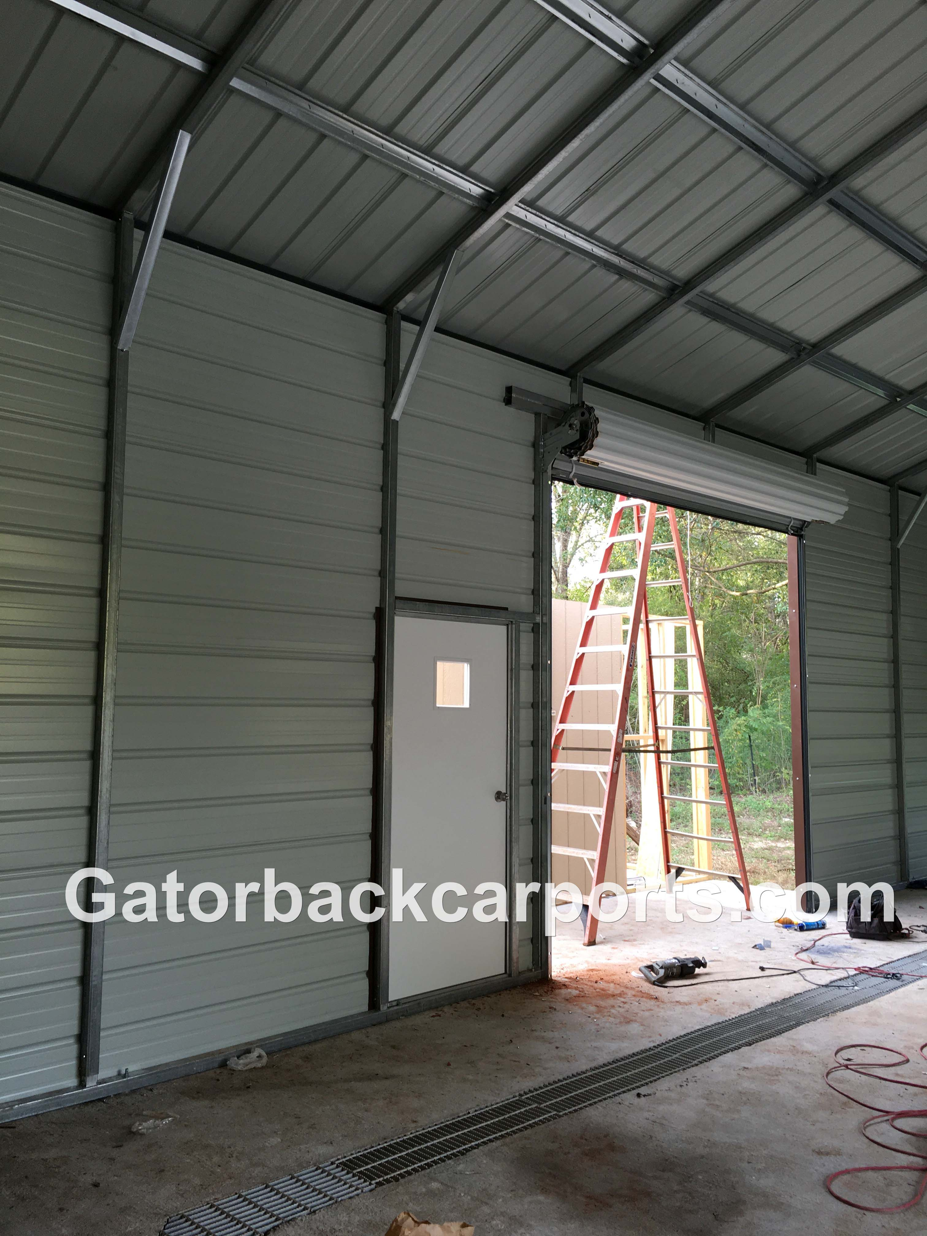 Look inside a steel garage job gatorback carports for Garage side entry door
